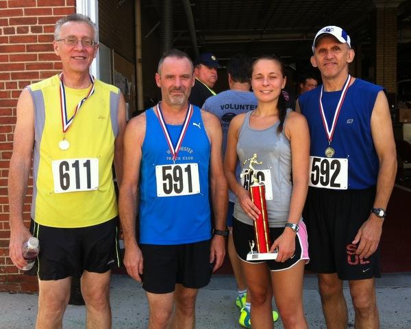 L to R: Wayne Rubin (first place 60-69), Dan Fanelli (3rd place 50-59), Jenny Kurtz (1st female), Bob Albanese (1st place 50-59). Photo courtesy or Maureen Carson.