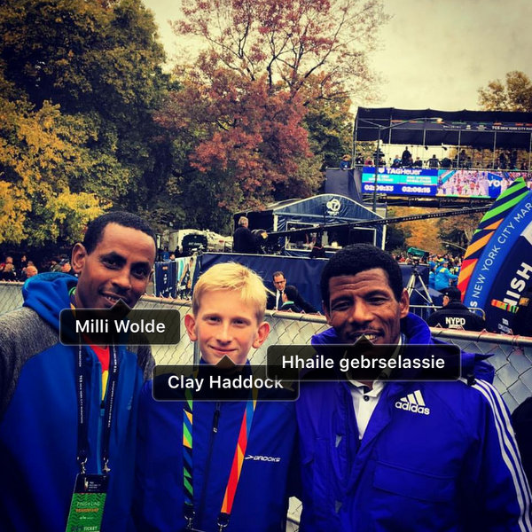 WTC Teammates Million Wolde. and Clay Haddock watch marathon finish with Haile Gebrselassie